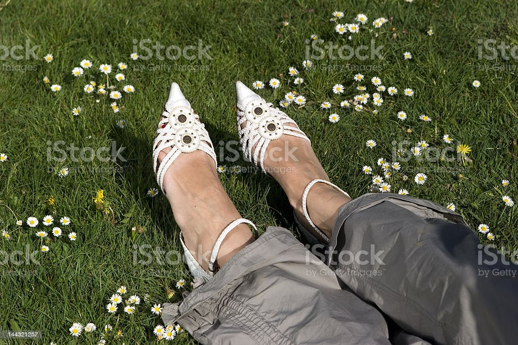 Foot in shoes on meadow royalty-free stock photo