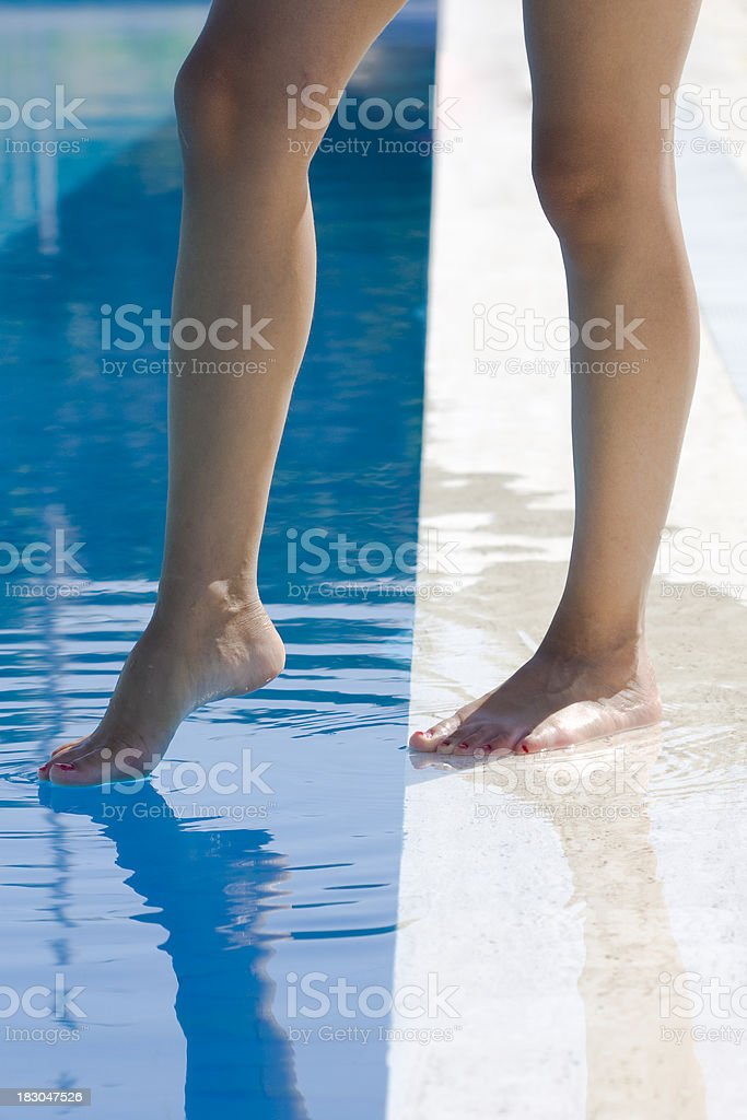Foot in the pool stock photo