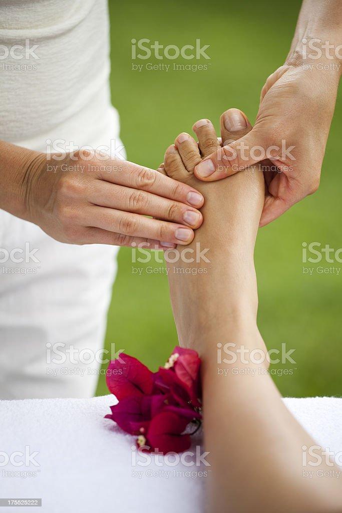 Foot massage at spa royalty-free stock photo