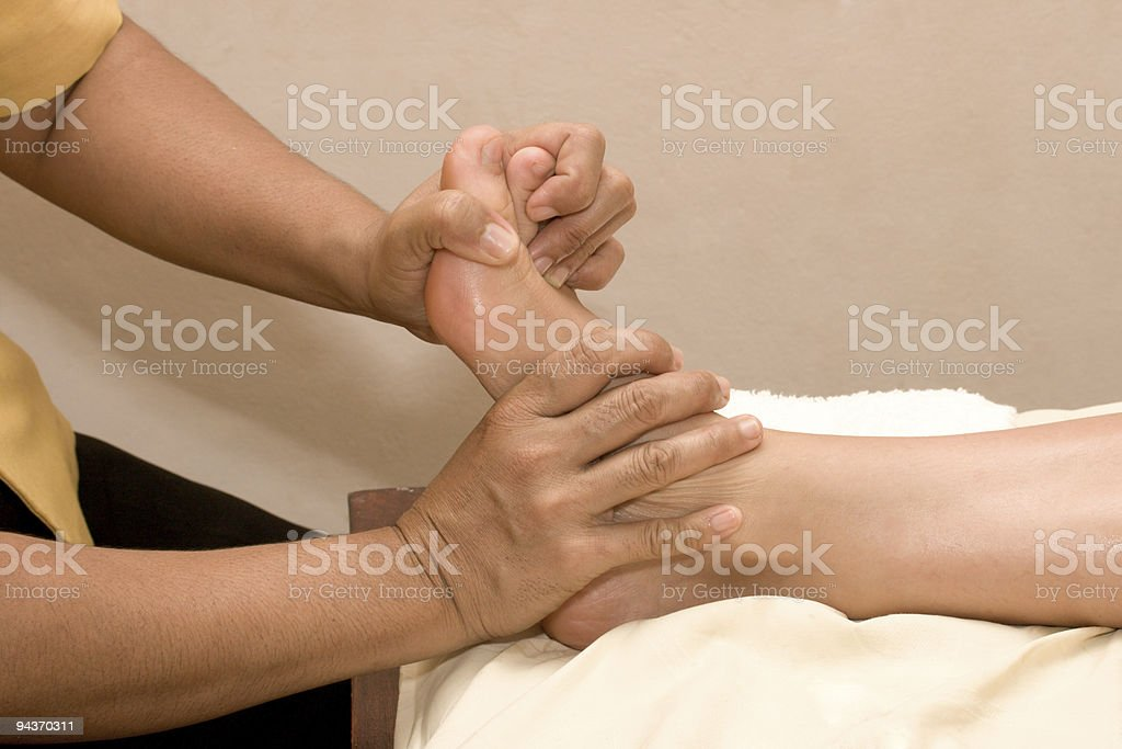 Foot massage in spa royalty-free stock photo