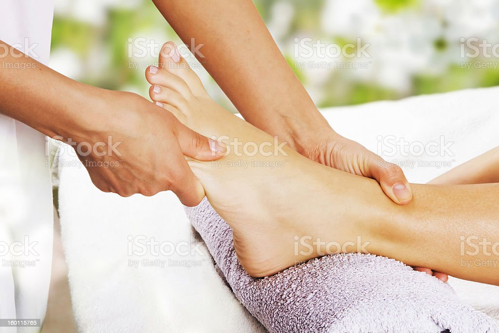 Foot massage in the spa salon stock photo