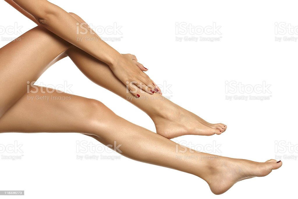 Foot massage of a woman with bare legs royalty-free stock photo