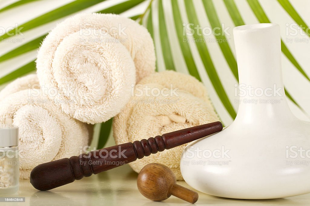 Foot massage stick with towels and oilment royalty-free stock photo