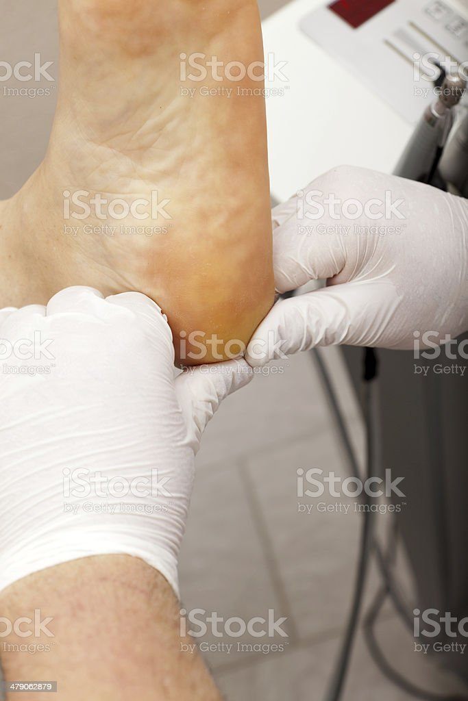Foot Massage with Oil Lotion royalty-free stock photo