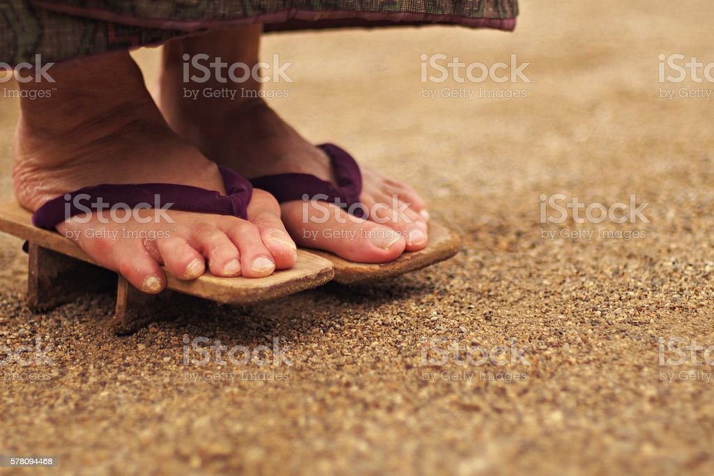 Foot of elderly woman in Geta stock photo