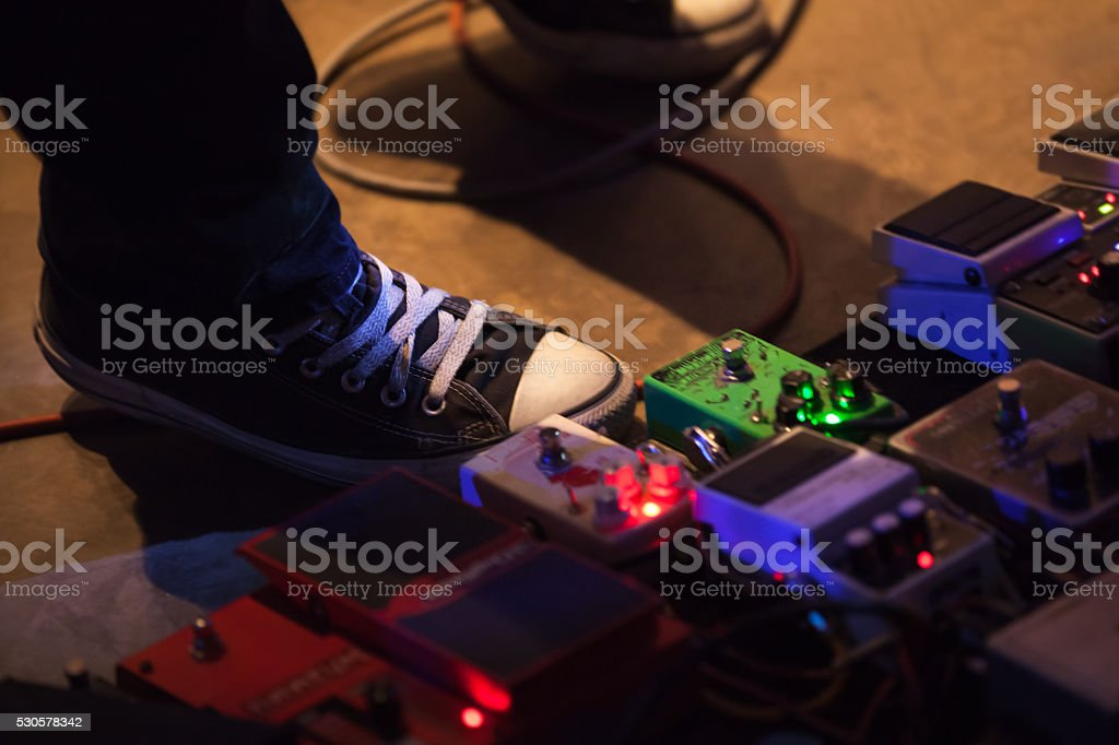 Foot of guitar player with effect pedals stock photo
