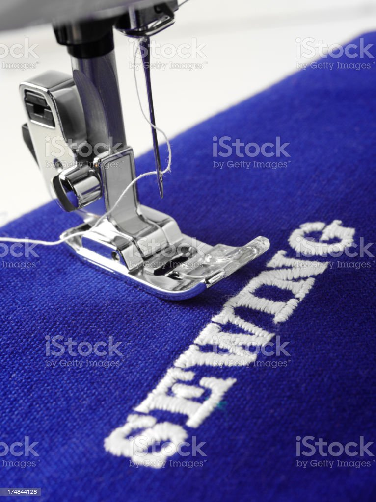 Foot of the Sewing Machine on a Blue Textile royalty-free stock photo