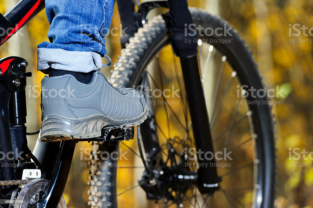 Foot on pedal stock photo