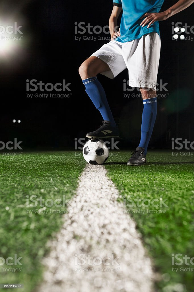 Foot on soccer ball mid field line stock photo