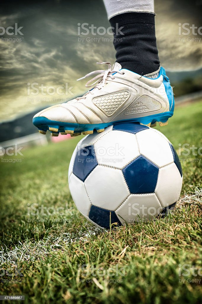 Foot on Soccer Ball royalty-free stock photo