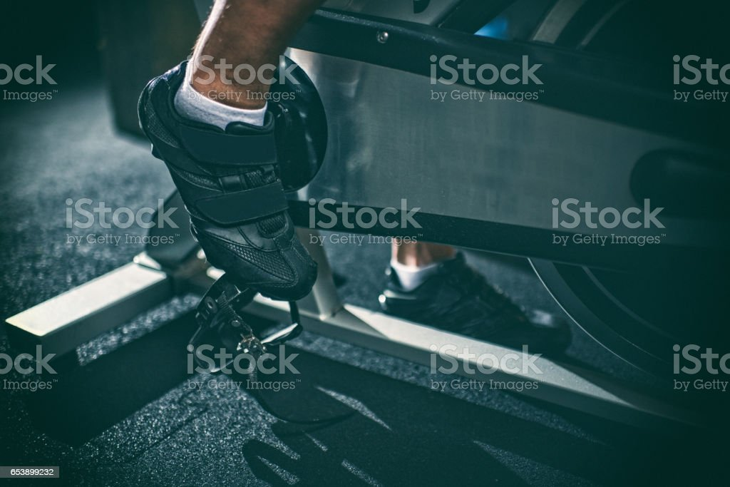 Foot on stationary bicycle stock photo