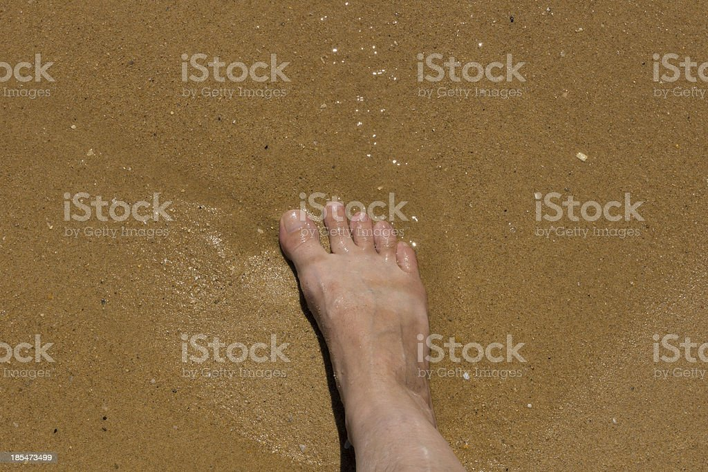 Foot on the beach stock photo