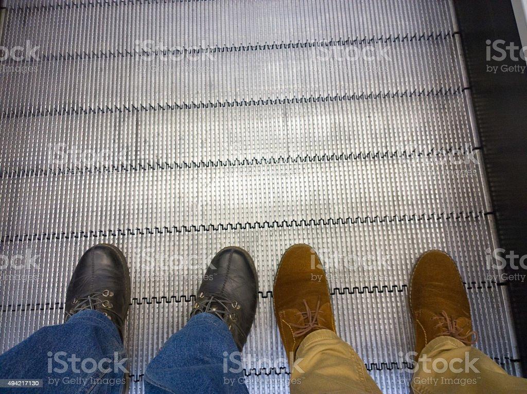 Foot on the escalator. stock photo