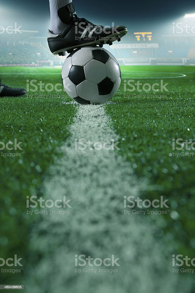 Foot on top of soccer ball stock photo