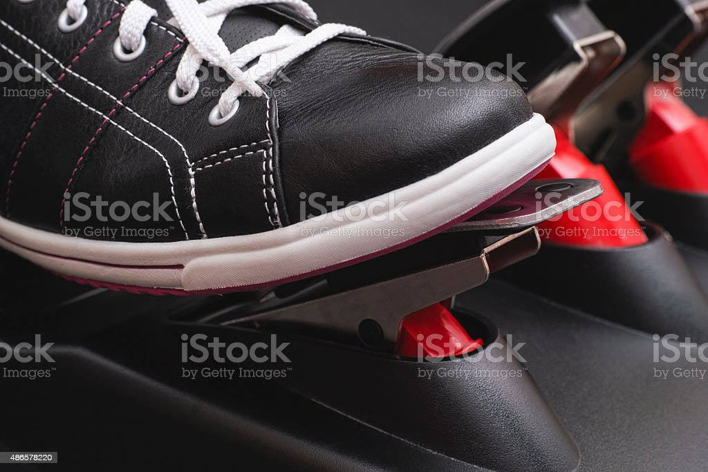 Foot pressing the gas pedal stock photo