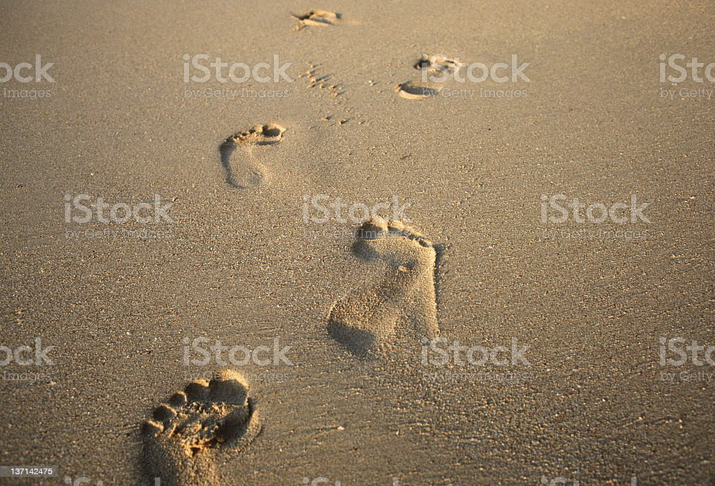 Foot prints in the sand on the beach stock photo