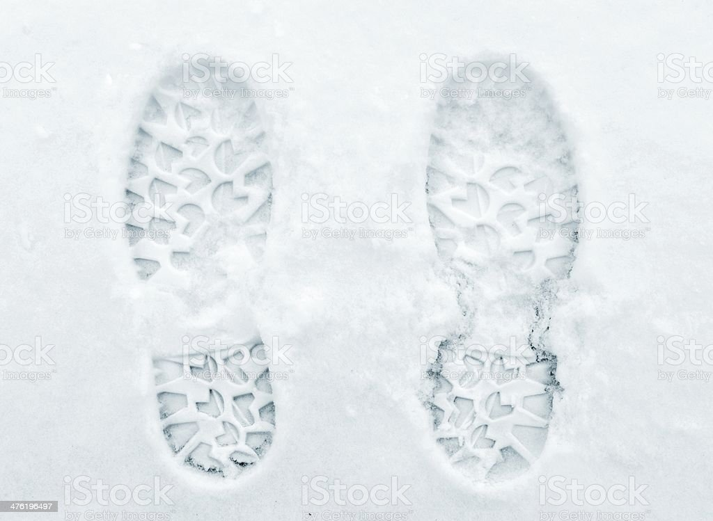 Foot prints on snow stock photo