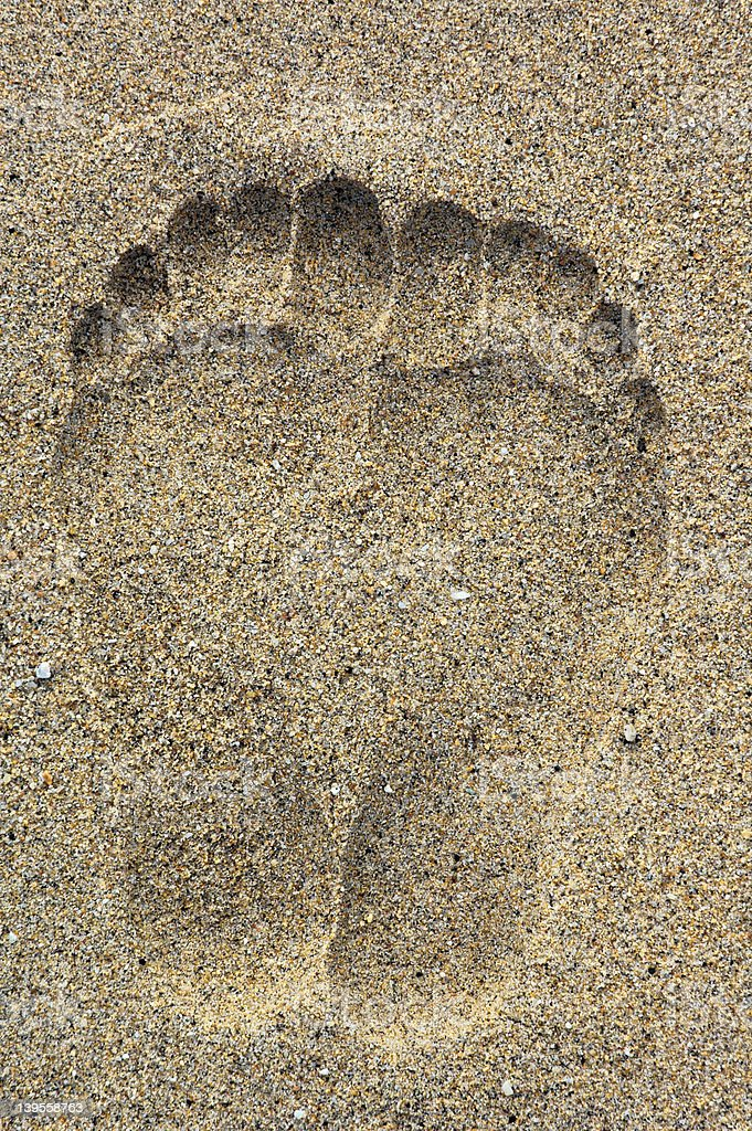 Foot prints on the sand royalty-free stock photo