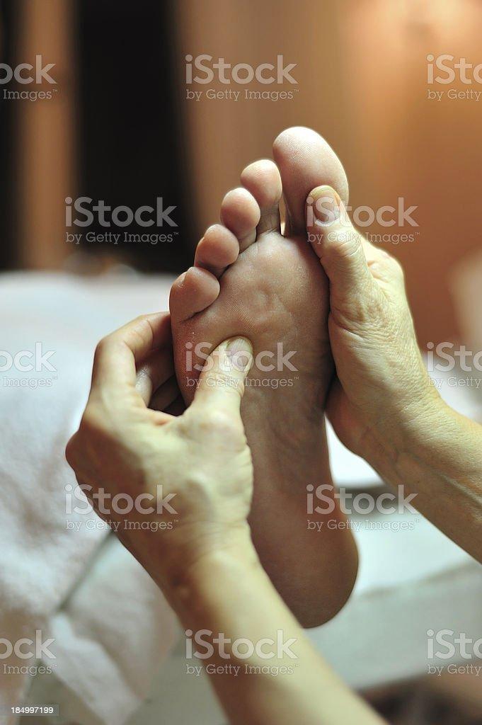 Foot reflexology massage 2 stock photo