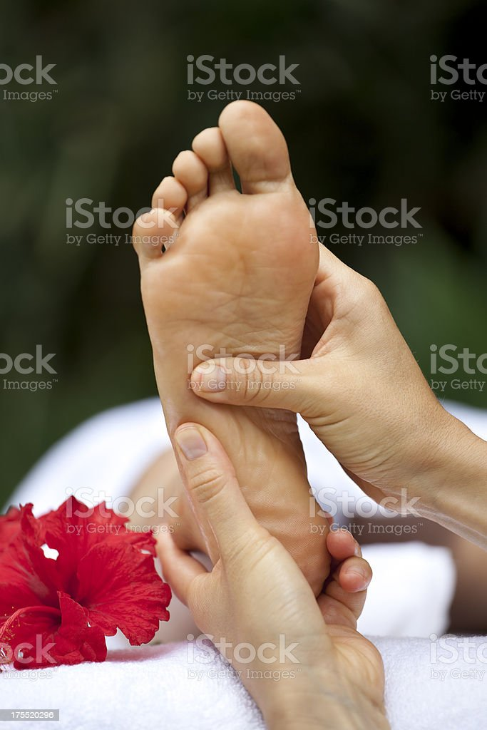 Foot reflexology massage at a spa stock photo