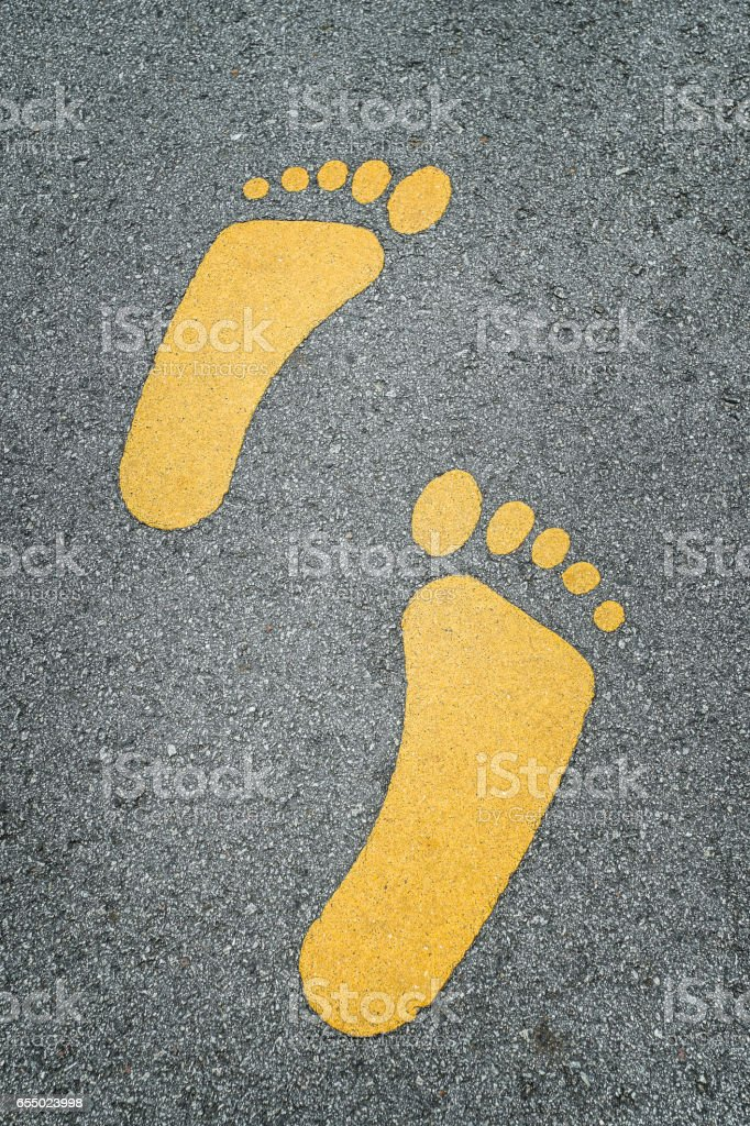 Foot sign on asphalt road stock photo