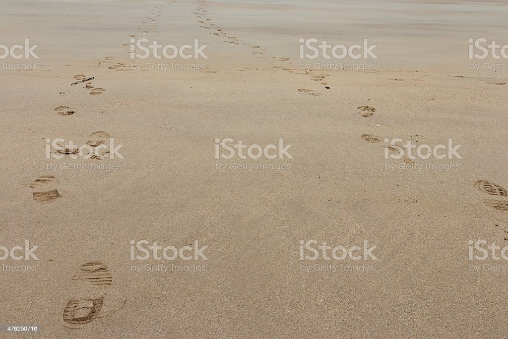 Foot steps in the sand royalty-free stock photo