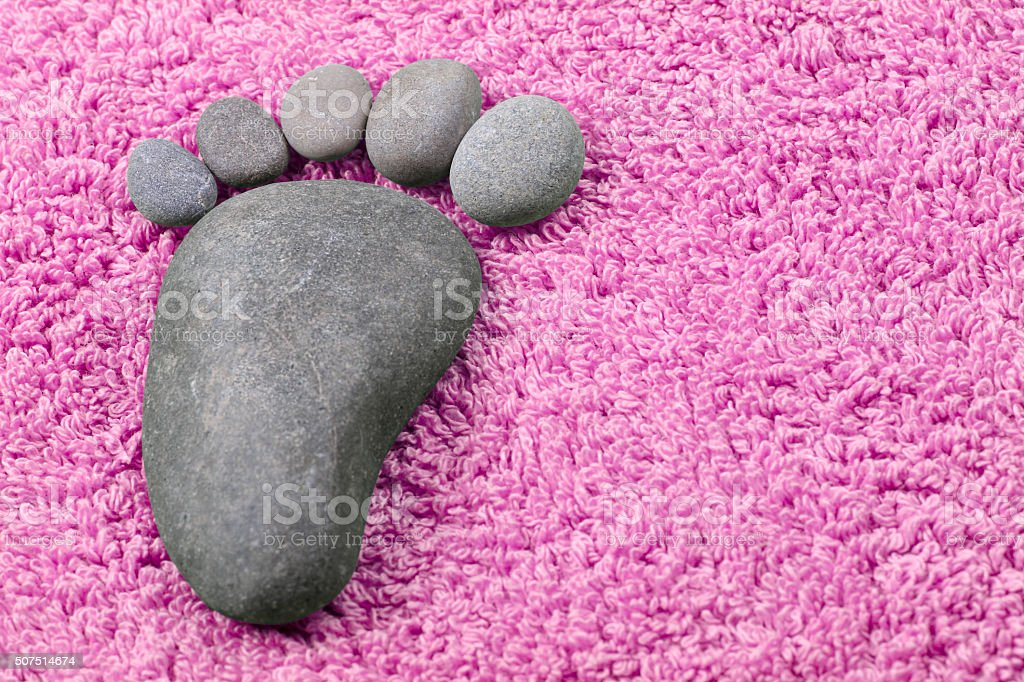 Foot symbol on terry towel stock photo