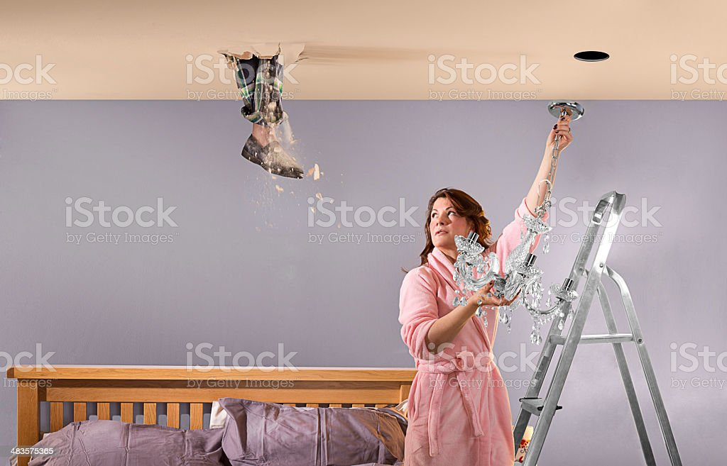 foot through ceiling stock photo