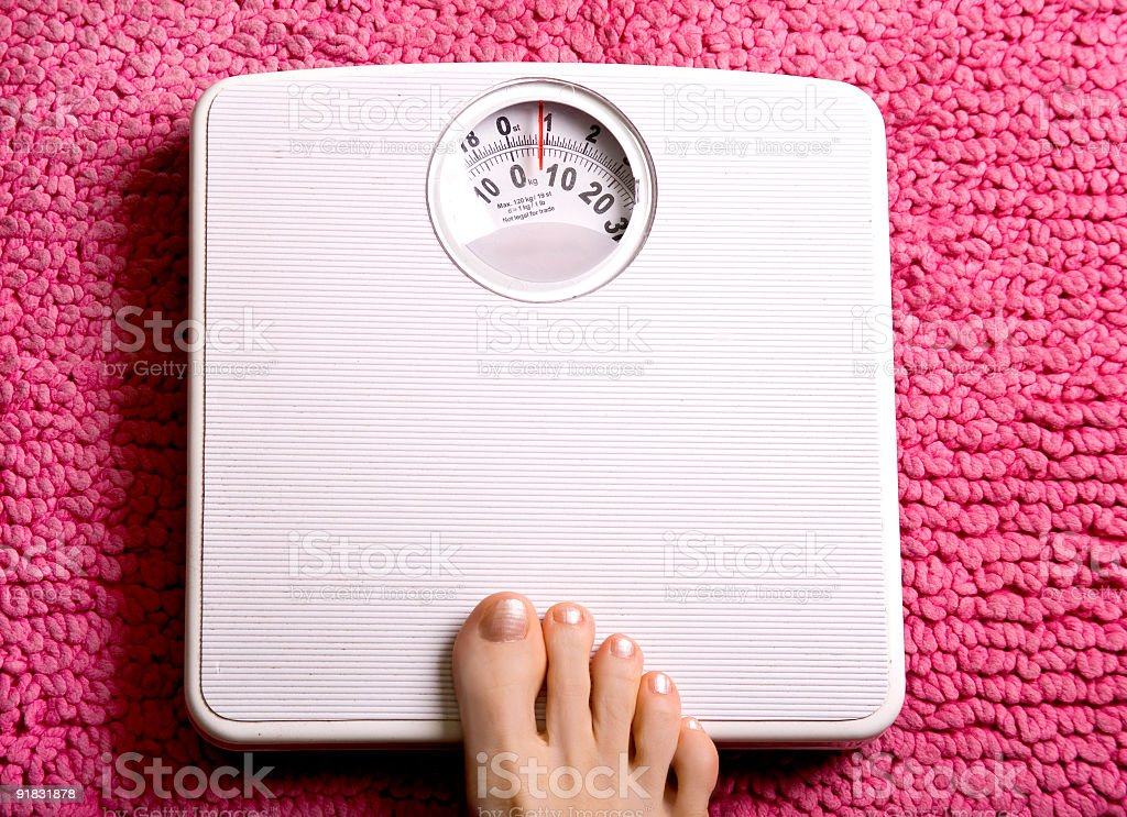 Foot weight stock photo