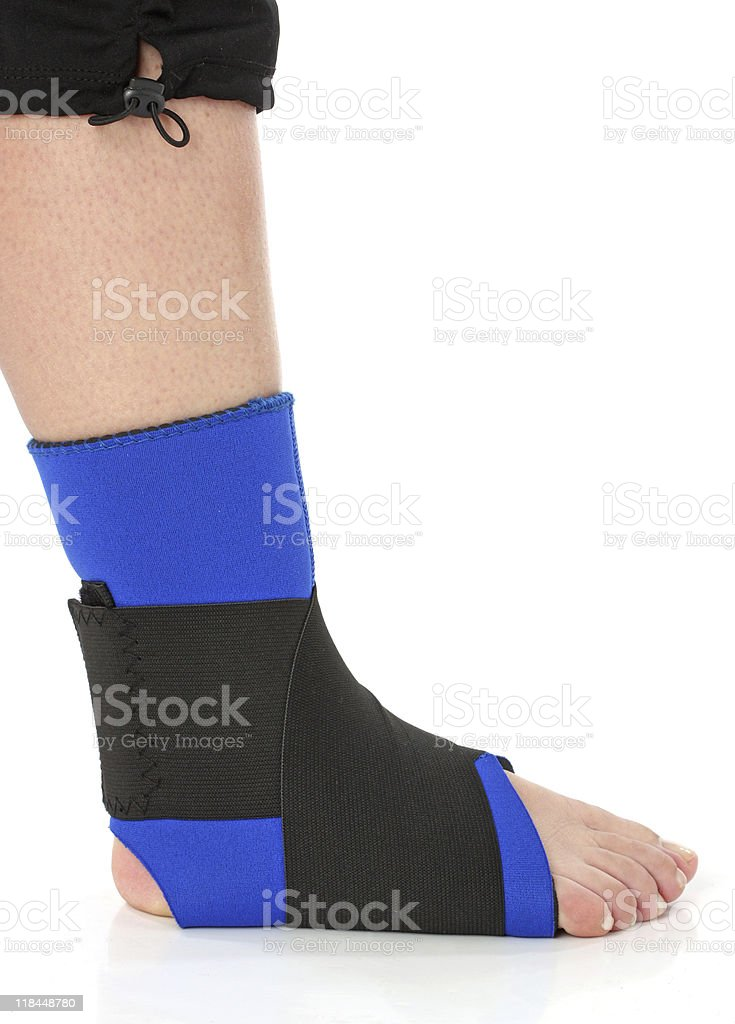 Foot with an ankle brace, over white royalty-free stock photo