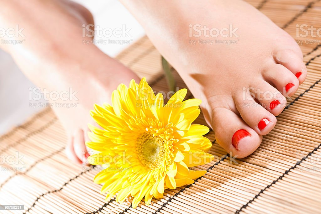 Foot with red nails stock photo