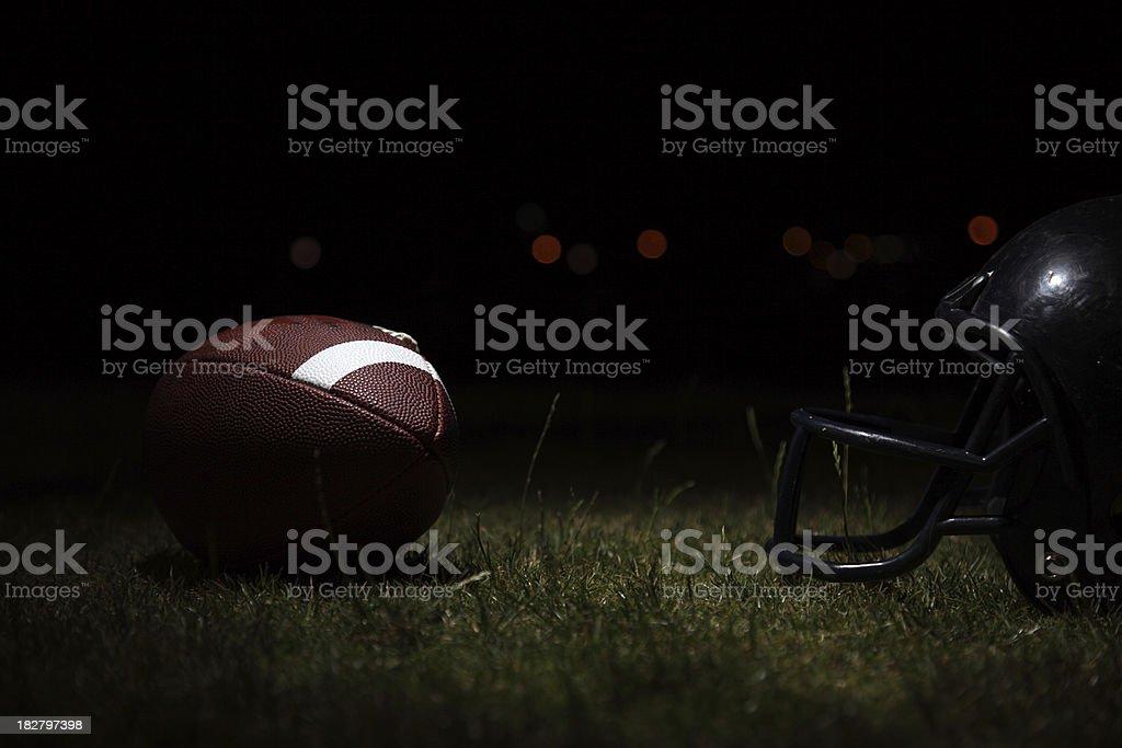 Football and helmet stock photo