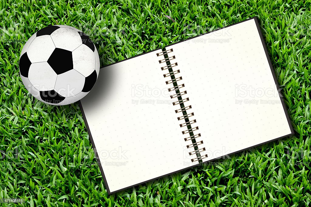 Football and notebook royalty-free stock photo