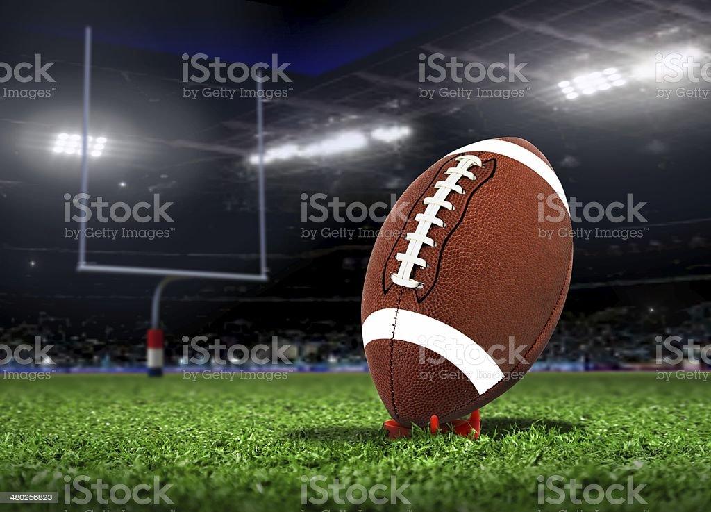 Football Ball On Grass in a Stadium stock photo