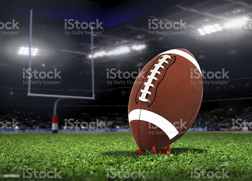 Football Ball On Grass in a Stadium stock photo