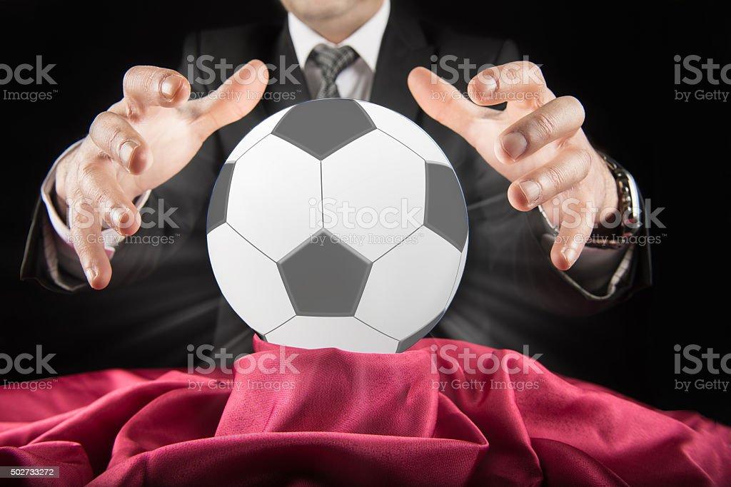 Football betting estimator looks at the crystal ball stock photo