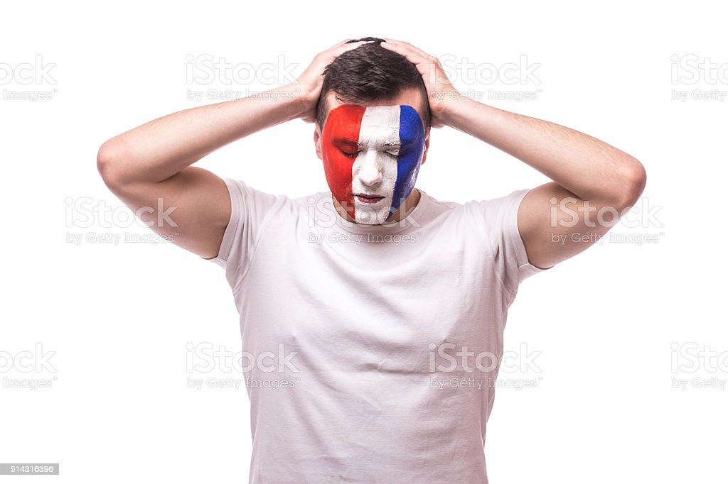 Football fan disapointed of lose game France national football team. stock photo
