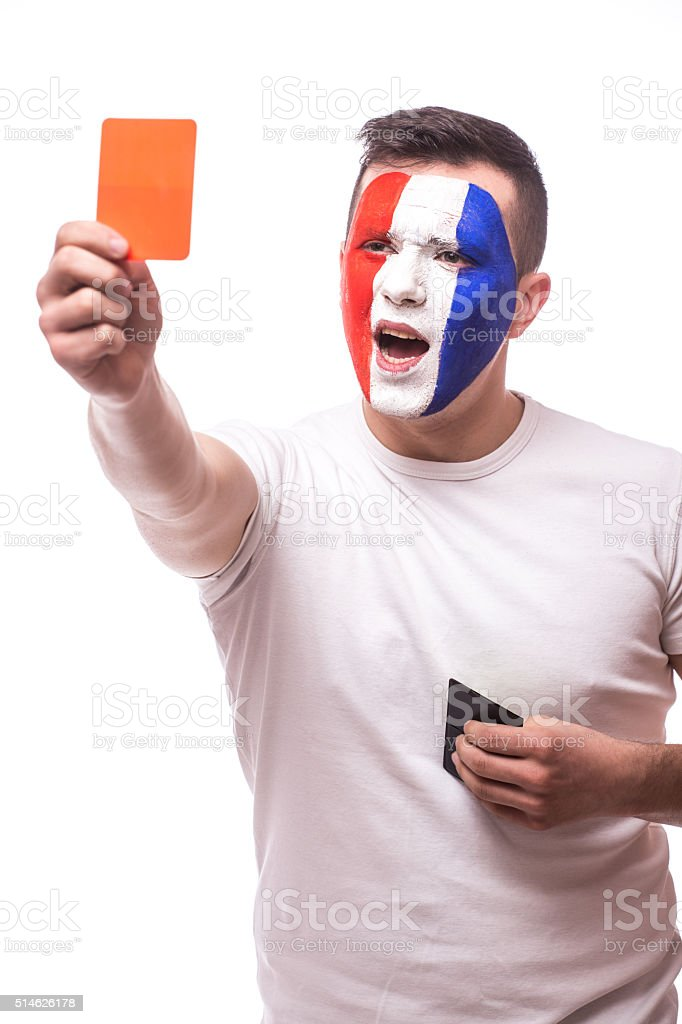 Football fan of France national team show red card camera stock photo