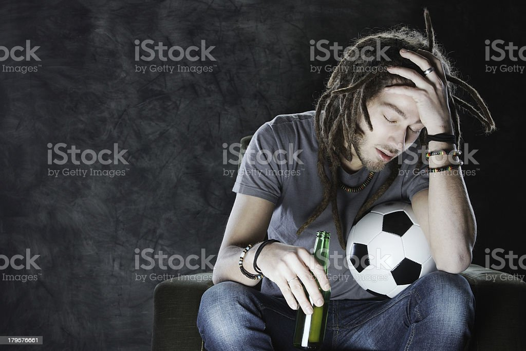 Football fan watching television royalty-free stock photo