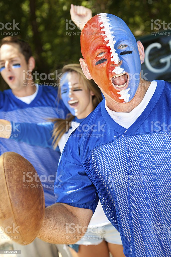 Football Fan With Face Painted Yelling at a Tailgate Party royalty-free stock photo