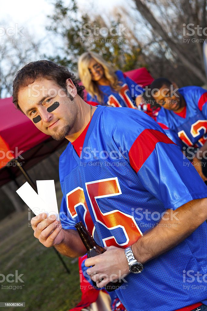 Football fan with tickets royalty-free stock photo