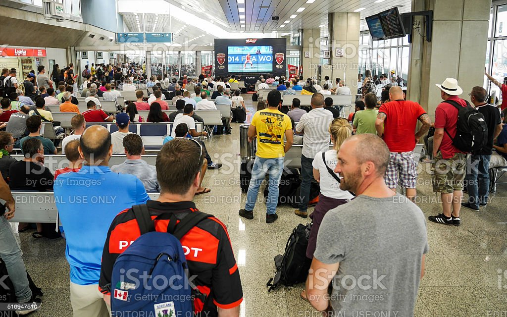 Football fans at Brasilia airport, Brazil stock photo