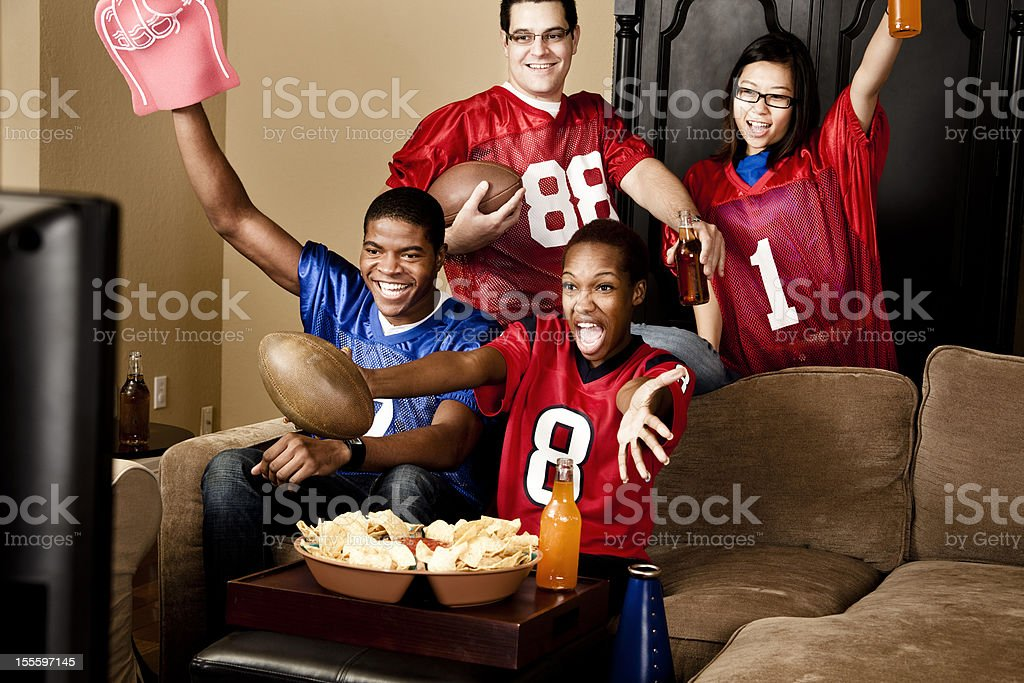 Football fans at home watching the game stock photo