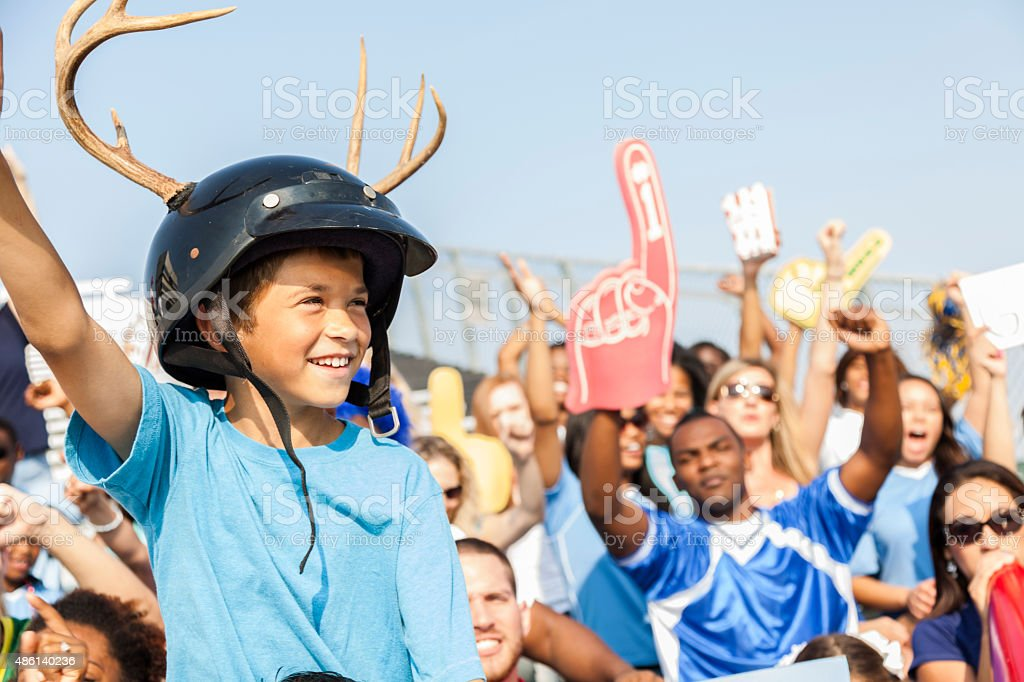 Football fans cheer for their team during sports event. Stadium. stock photo