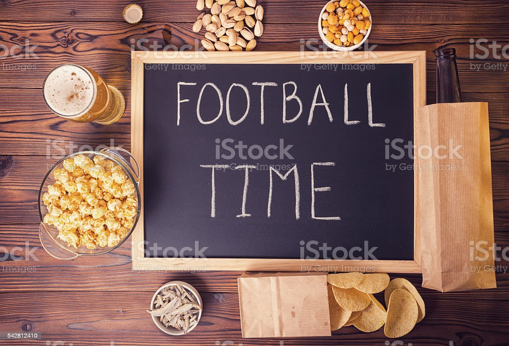 football fans concept of beer bottle in brown paper bag, stock photo