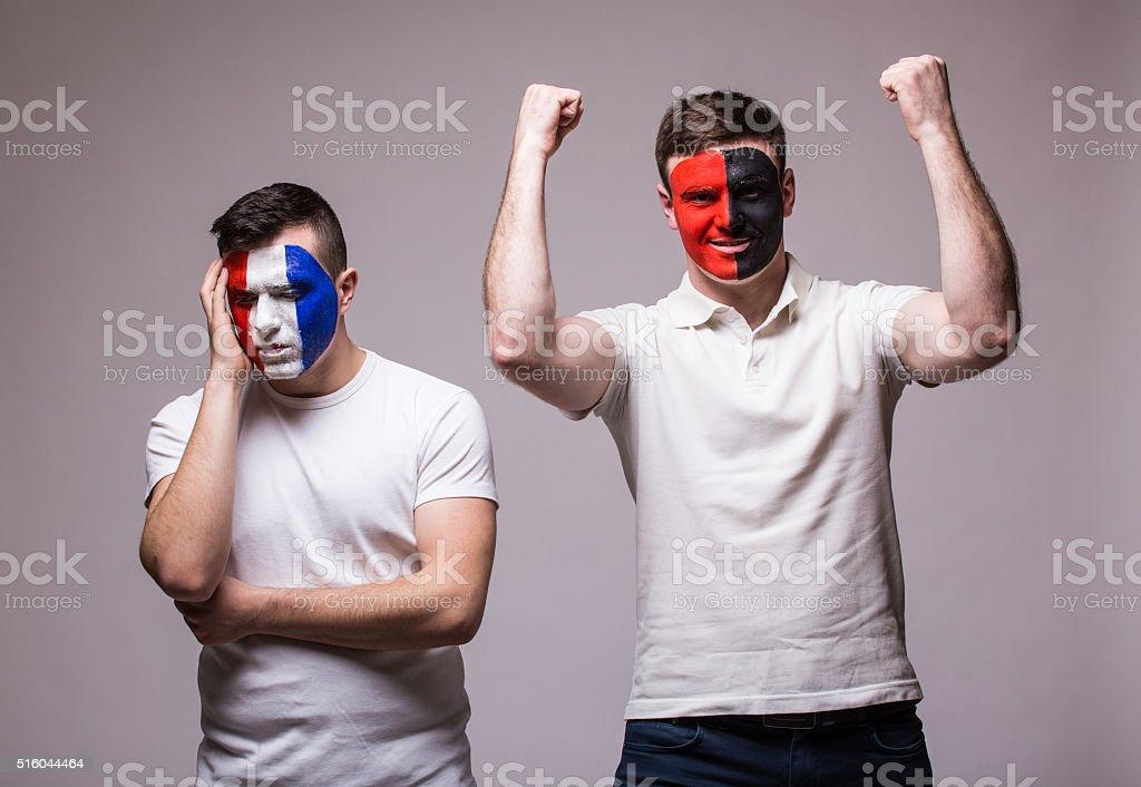 Football fans: France lose, Albania win. European 2016 football fans stock photo
