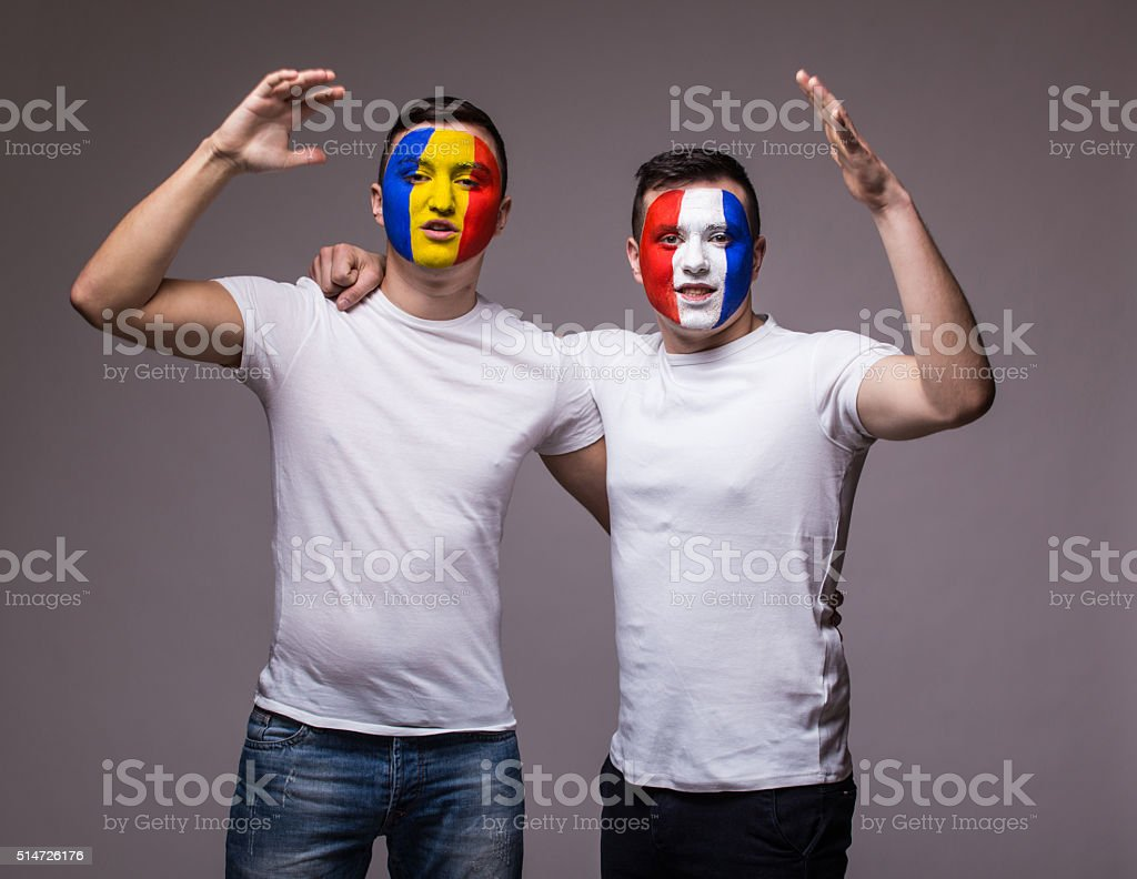 Football fans of France and Romania national teams friendly support stock photo