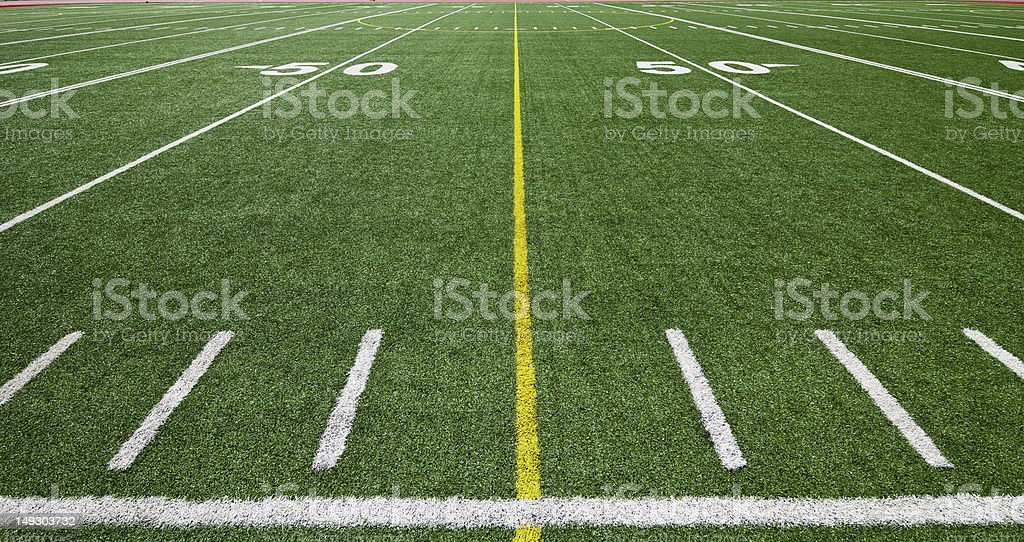 Football field at the 50 yard line stock photo