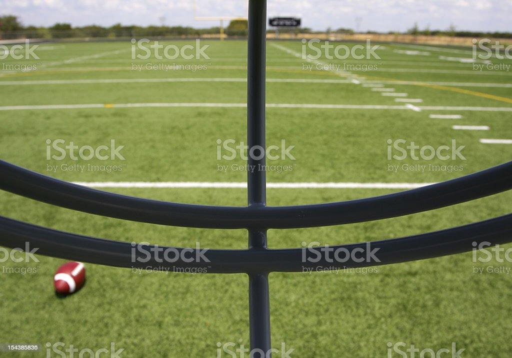 Football Field through the Helmet Facemask stock photo