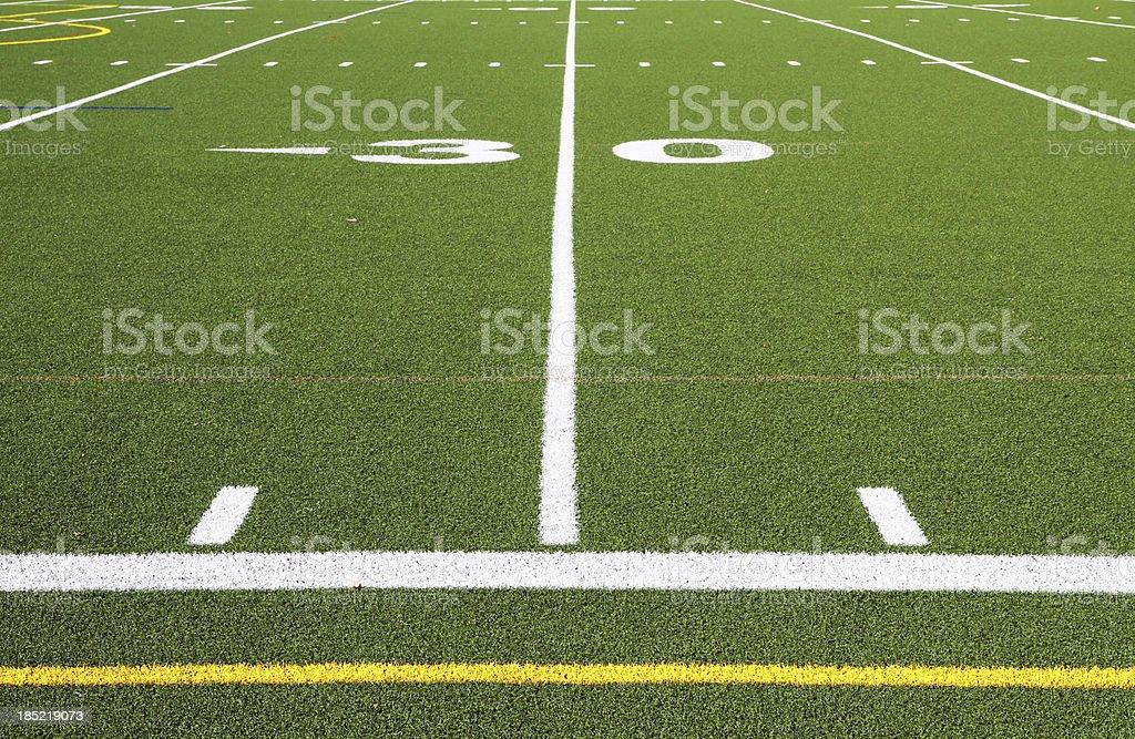 Football field turf at 30 yard line stock photo